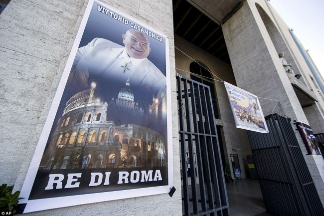 City landmarks: One banner read 'King of Rome', featuring Casamonica's image, the Colosseum and St Peter's Basilica